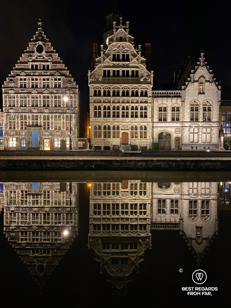 Medieval houses along the Graslei reflecting in the river in the old town of Ghent, Belgium