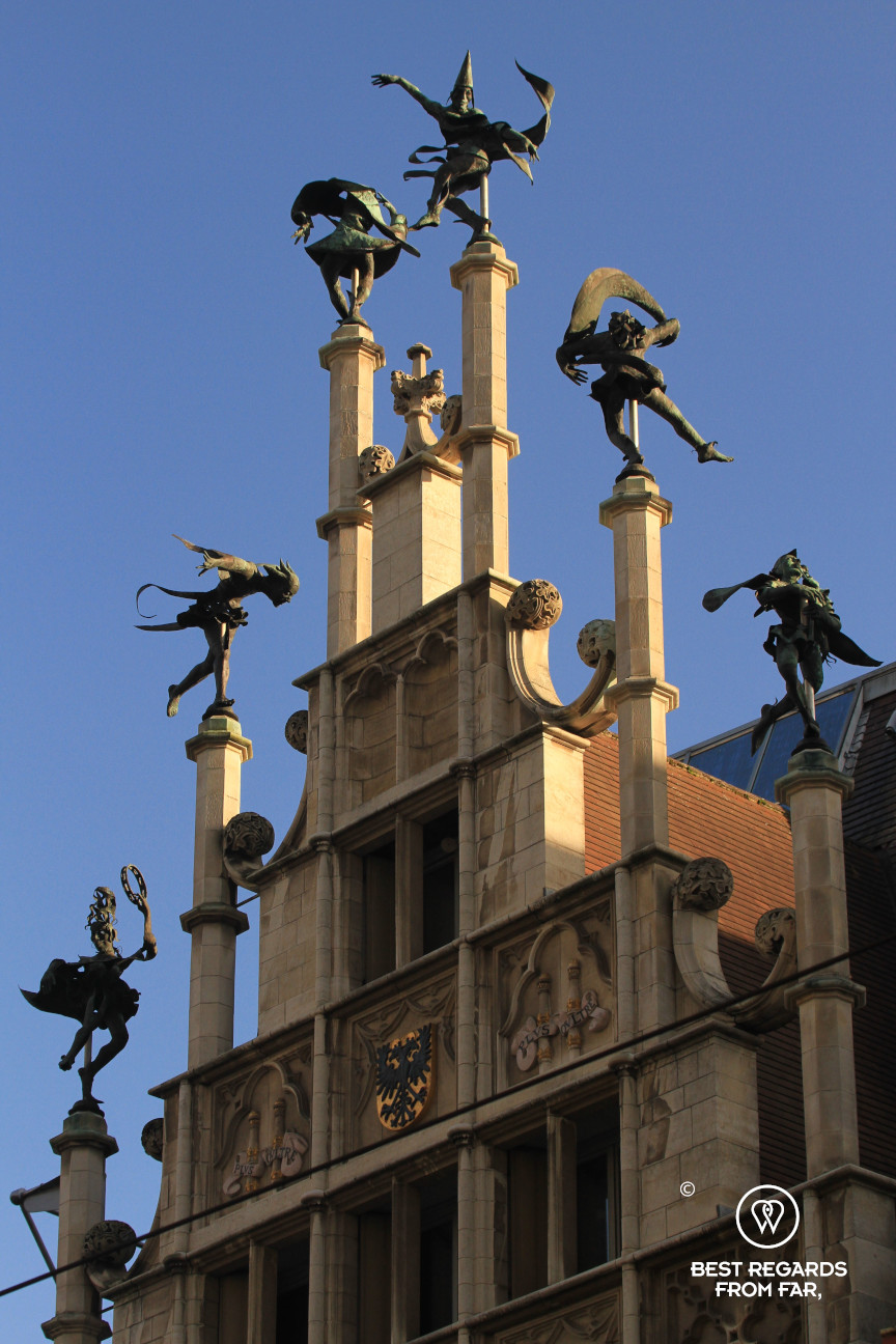 Facade of the restored mason's house in Ghent with its dancers on top, Belgium