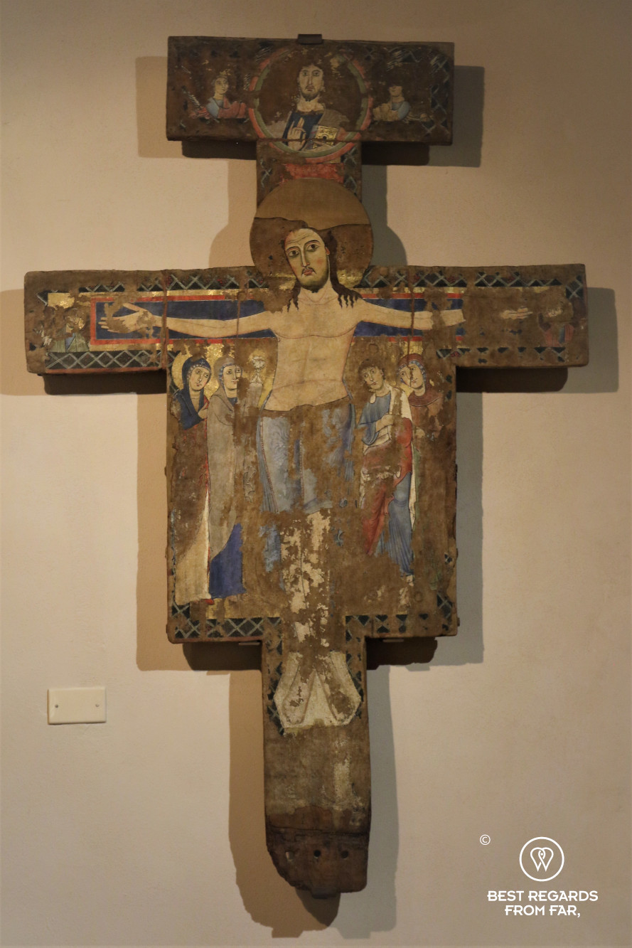 Medieval Sienese Crucifix at the Pienze museum, Tuscany by Vespa, Italy