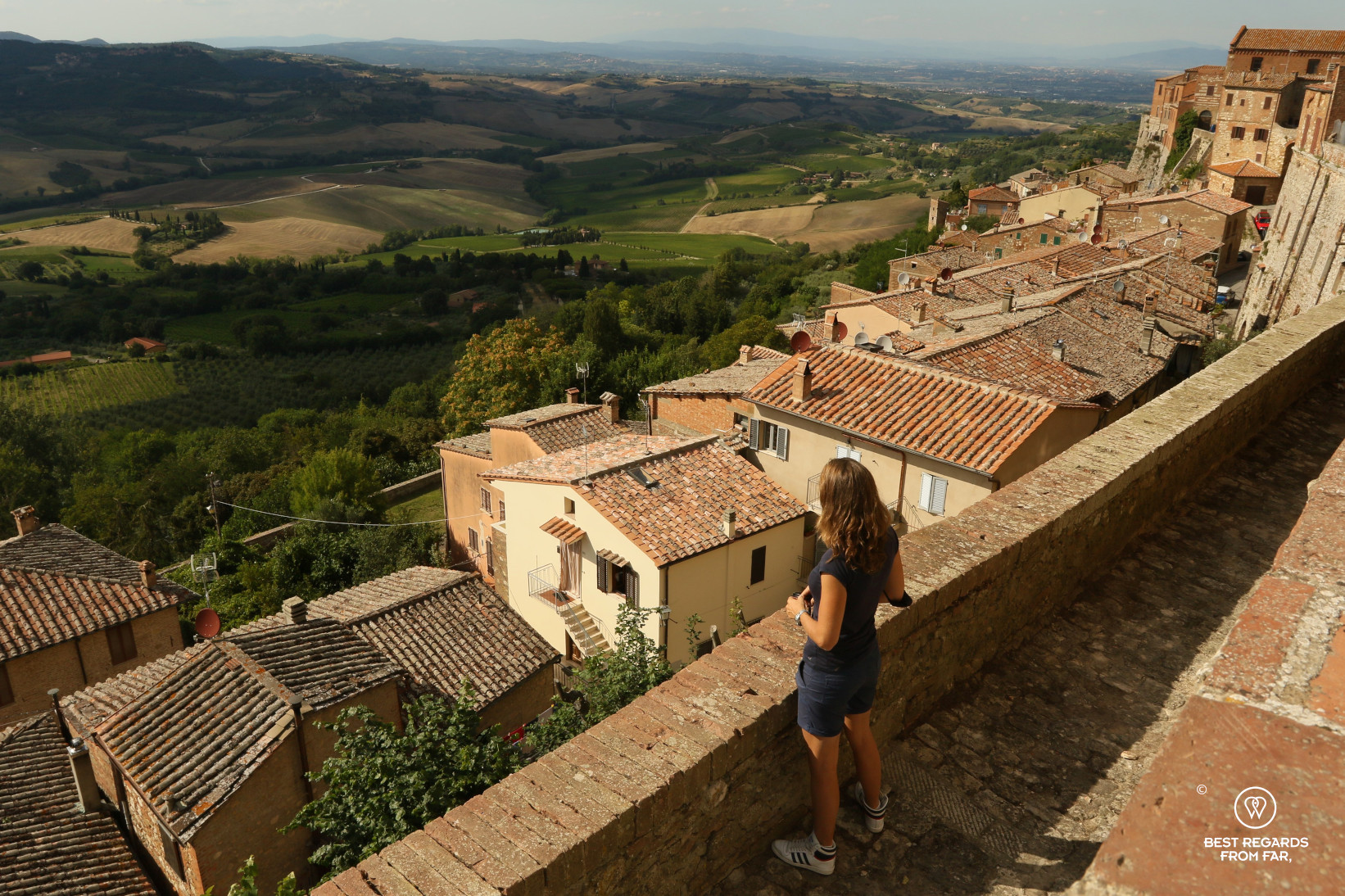 Woman in shorts taking in the the rooftops and views on the vineyards
