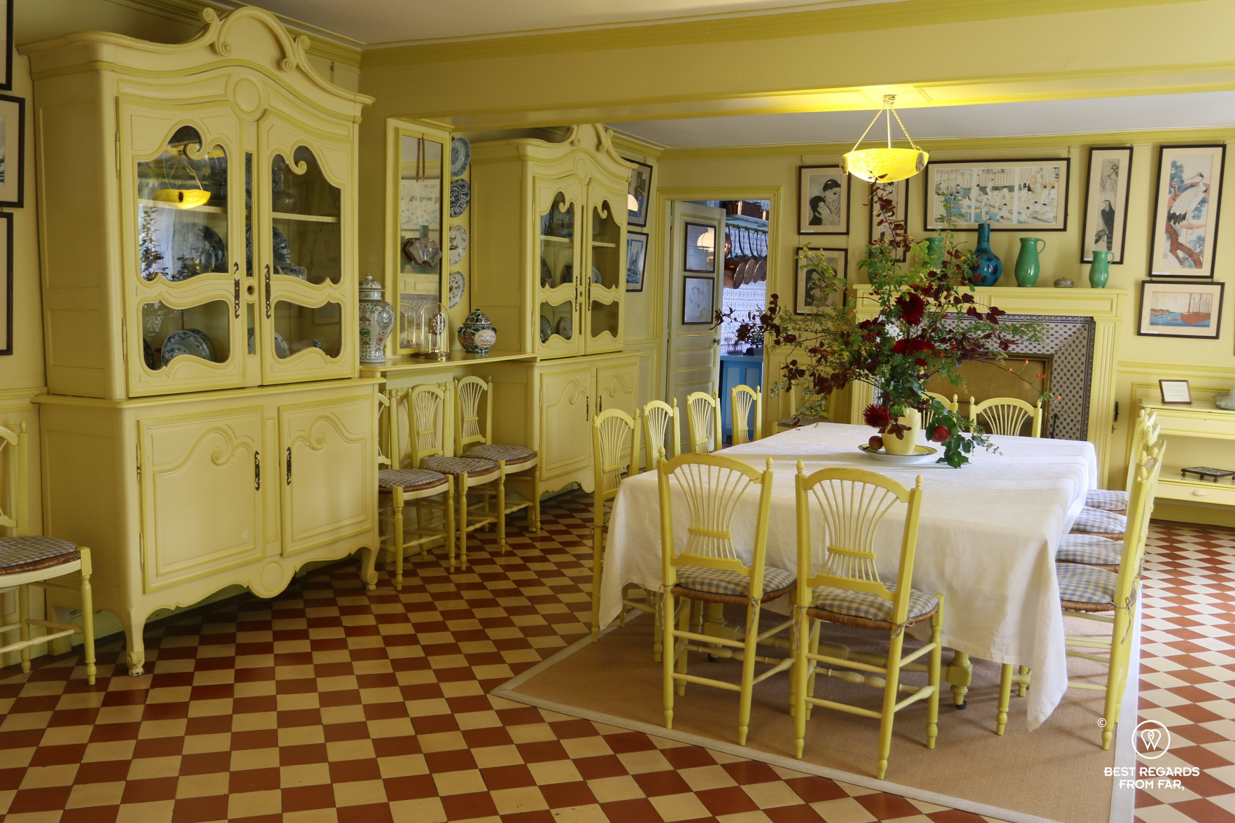 The modern yellow dining room in Claude Monet's house in Giverny, France