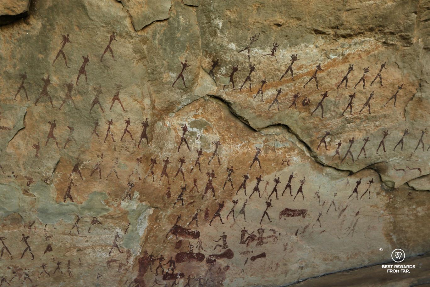 Bushmen rock art representing a tribe, Drakensberg, South Africa.