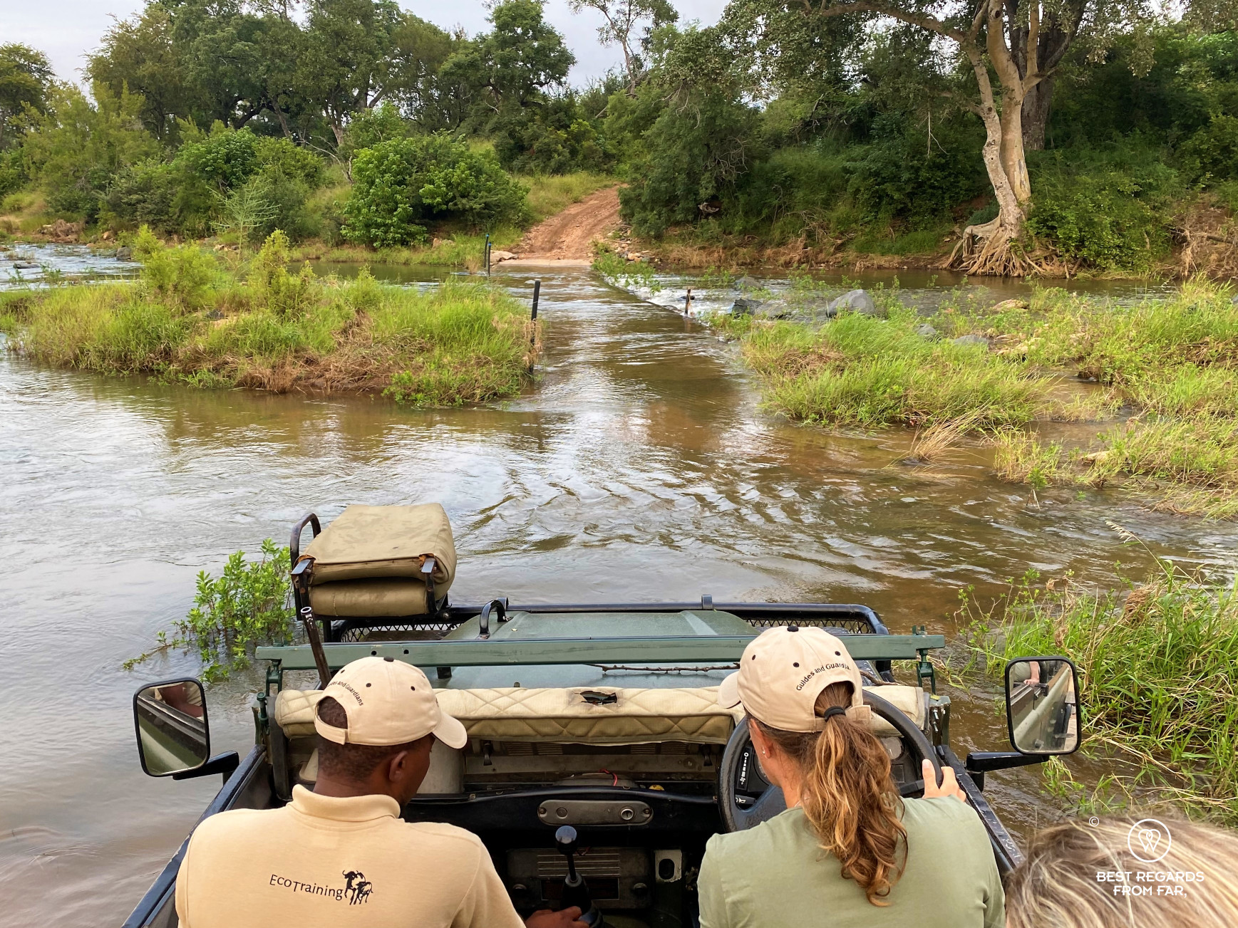 Photographer Marcella van Alphen driving the 4x4 Land Rover across the Selati River