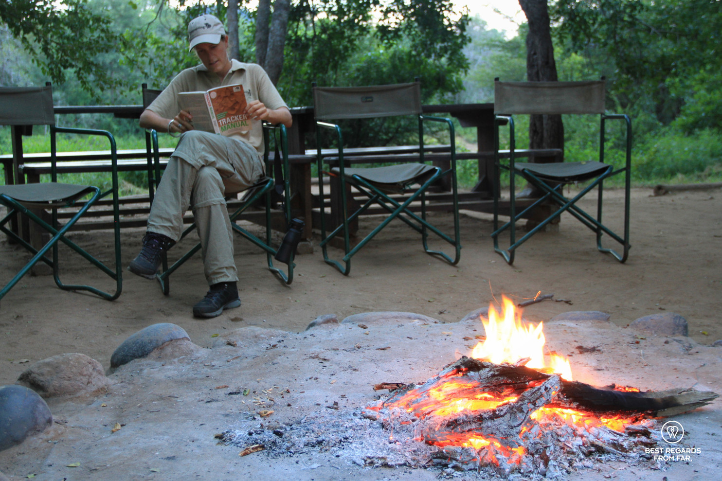 Photographer Marcella van Alphen studying the theory of tracking at the Selati camp by the fire
