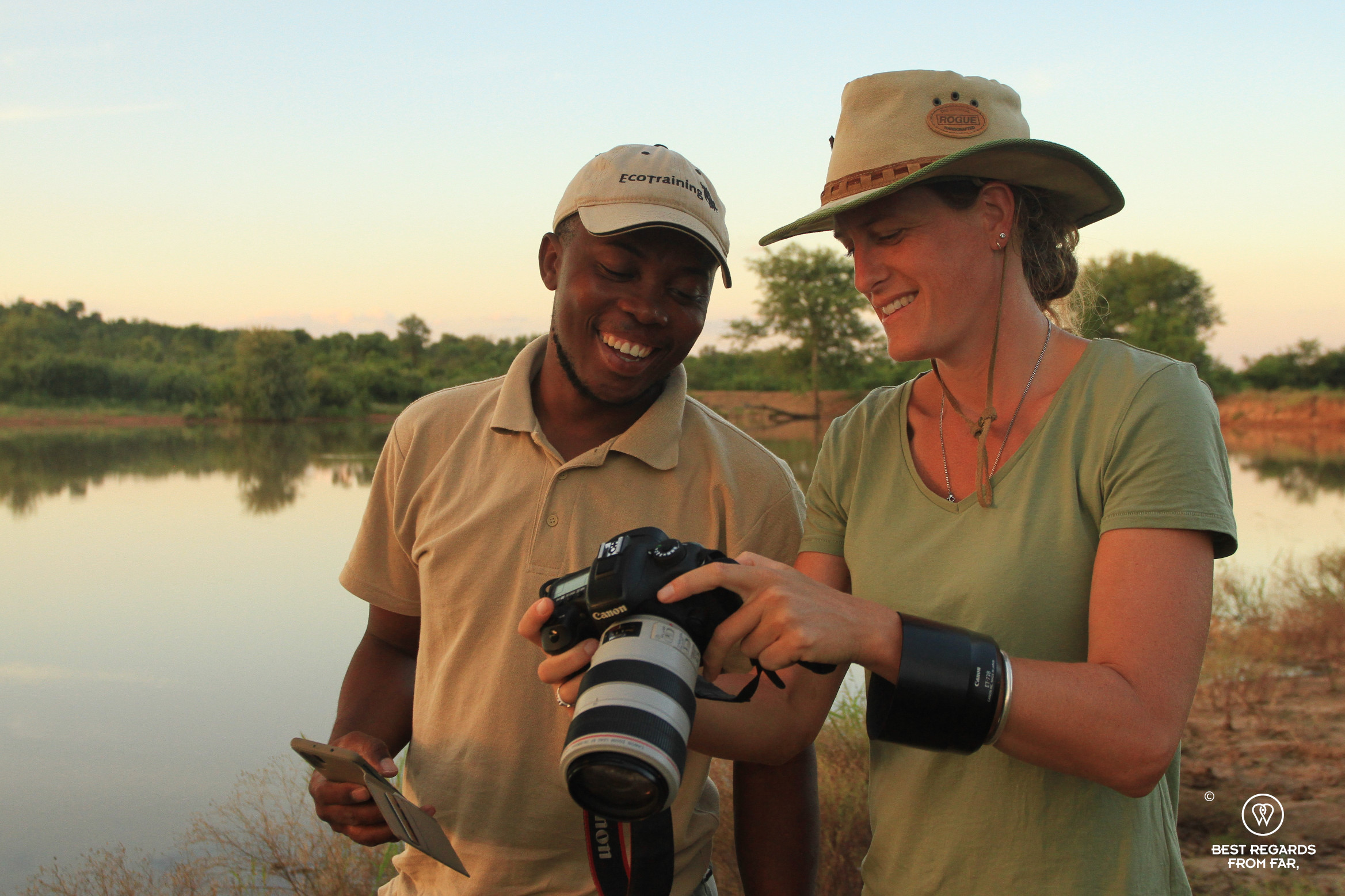 Photographer Marcella van Alphen showing a photo to EcoTracker instructor Norman Chauke in the African bush