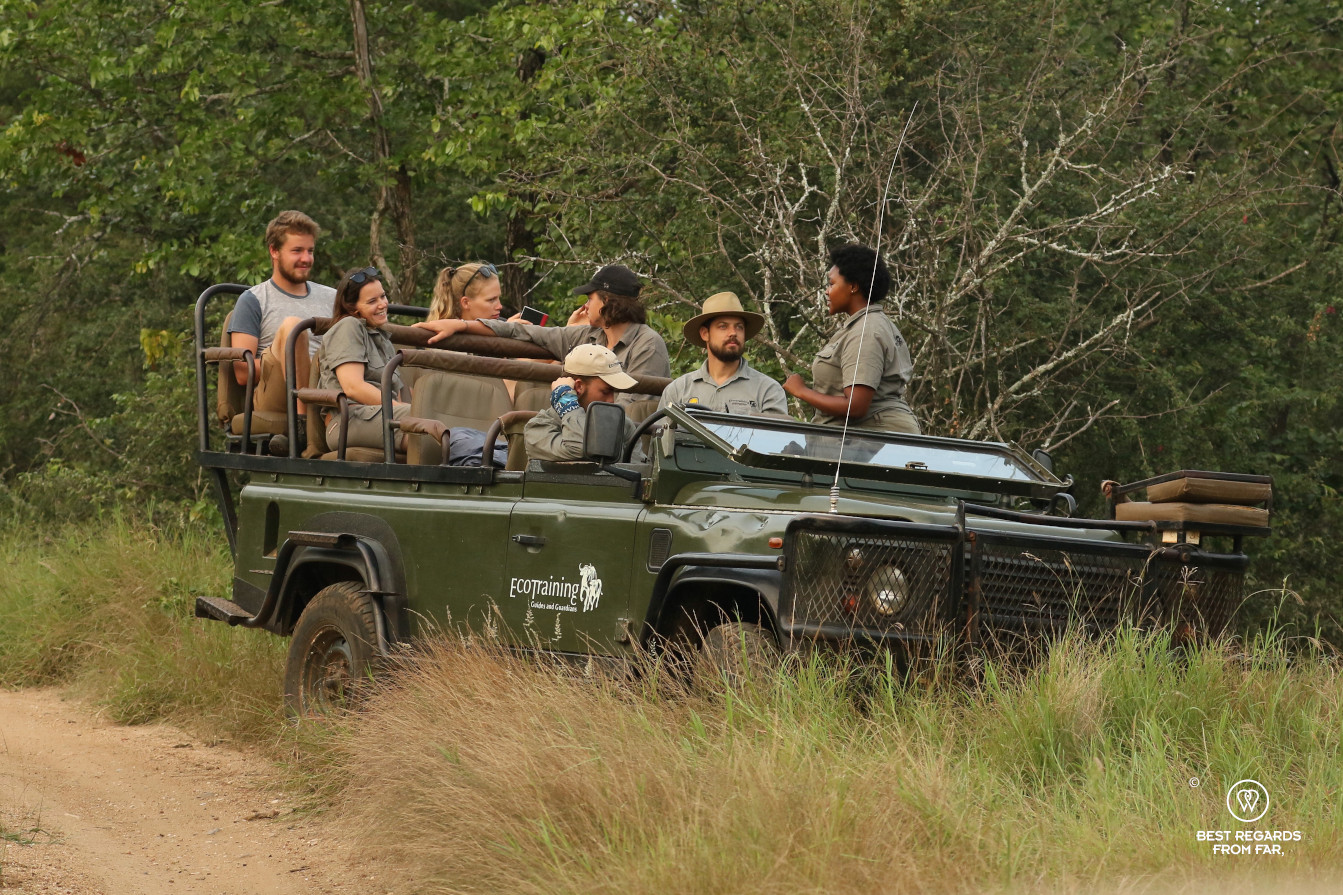 Students on a field guide training in an EcoTraining Land Rover in the African bush
