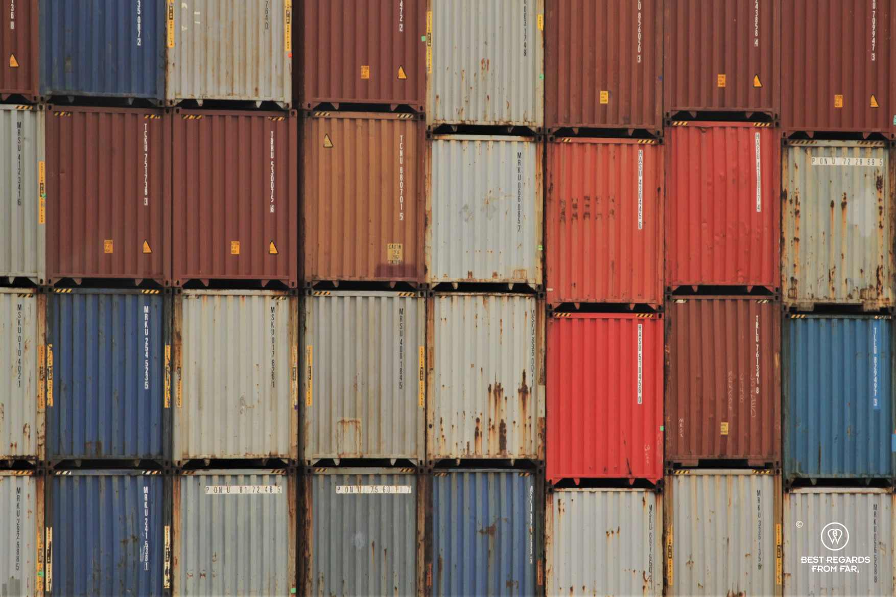 Colourful containers piled up in the industrial harbour of Antwerp, Belgium