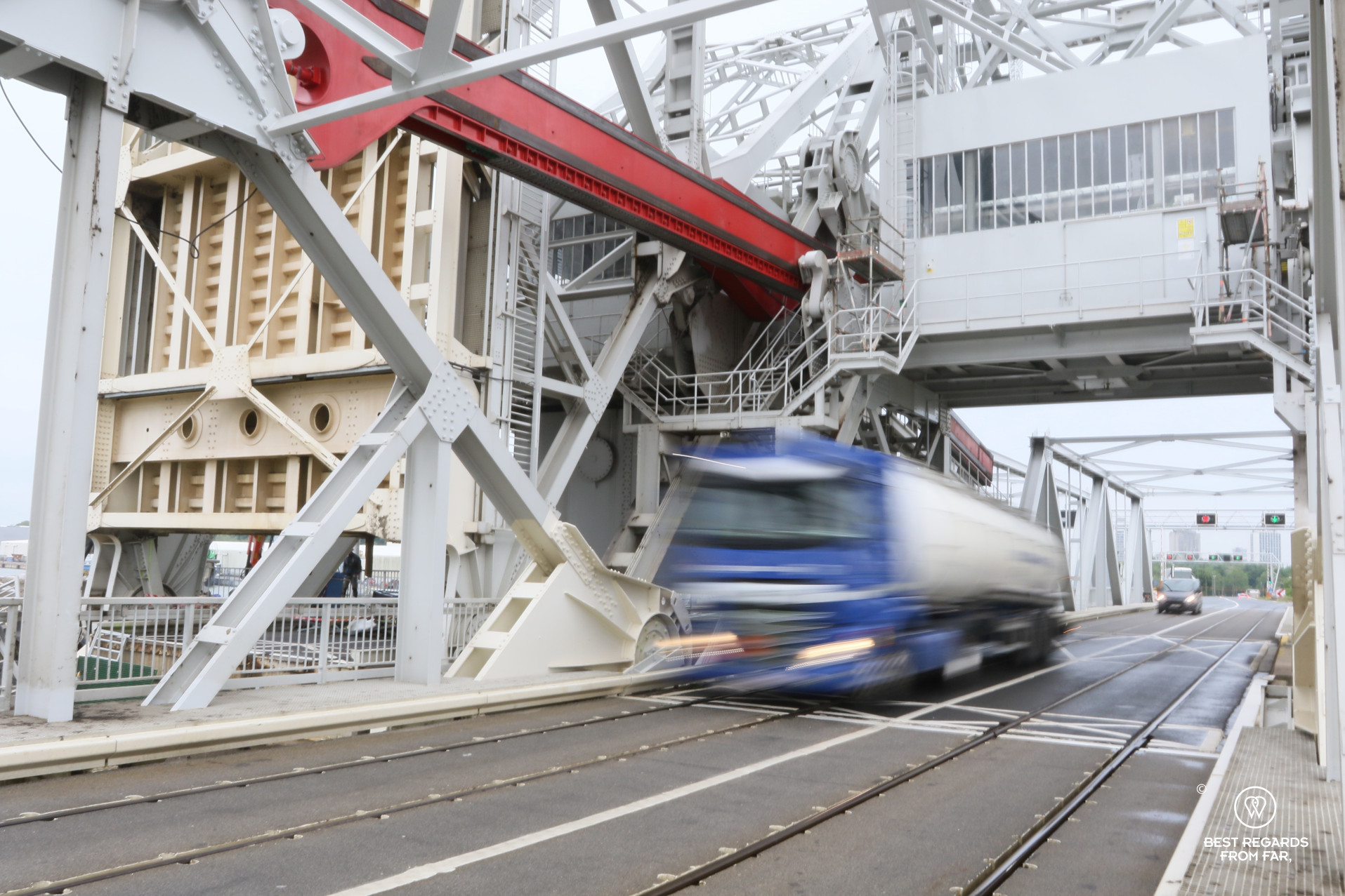 Truck passing fast on a bridge with train tracks in the industrial harbour of Antwerp, Belgium