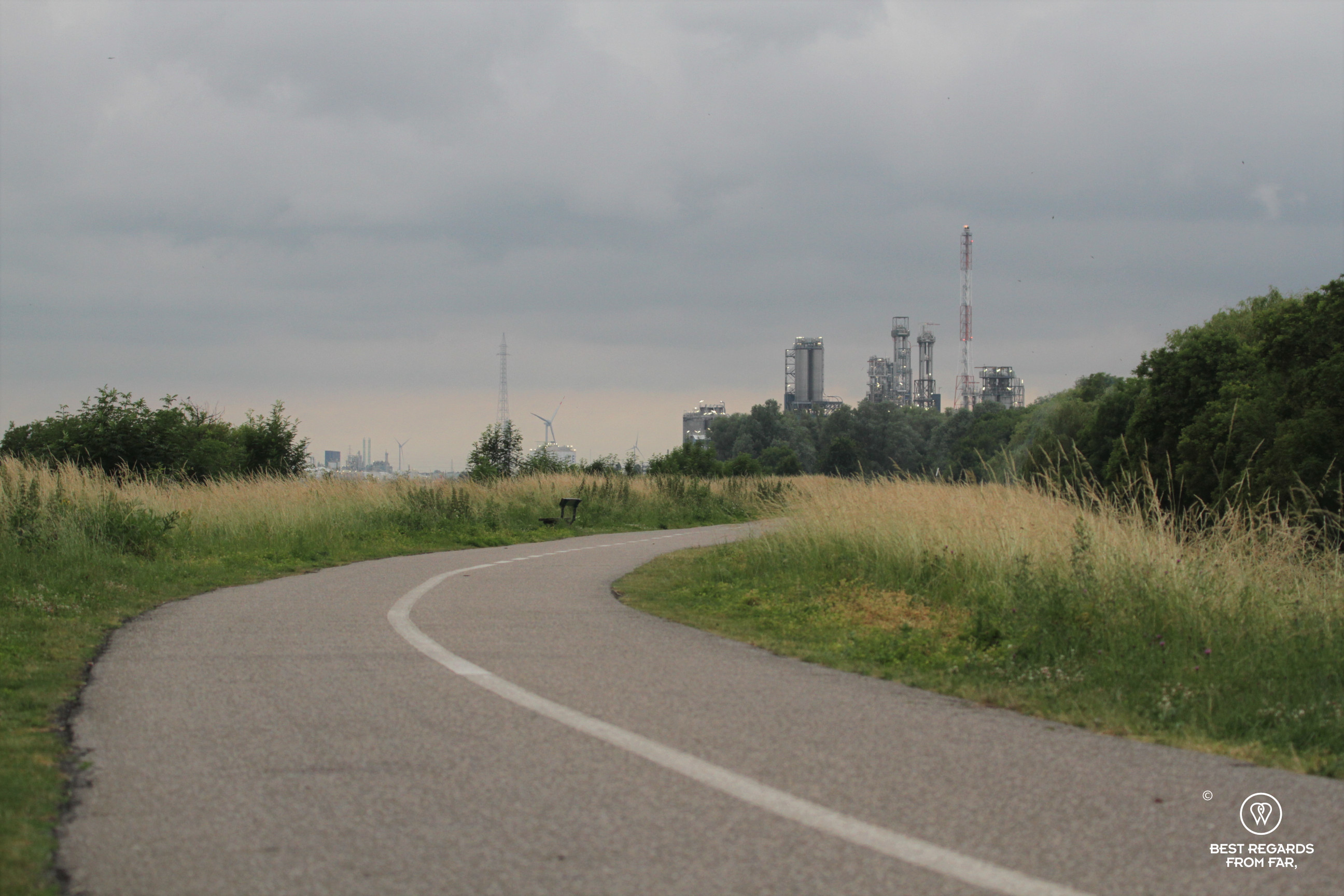 Cycle path leading to a refinery in the industrial harbour of Antwerp, Belgium