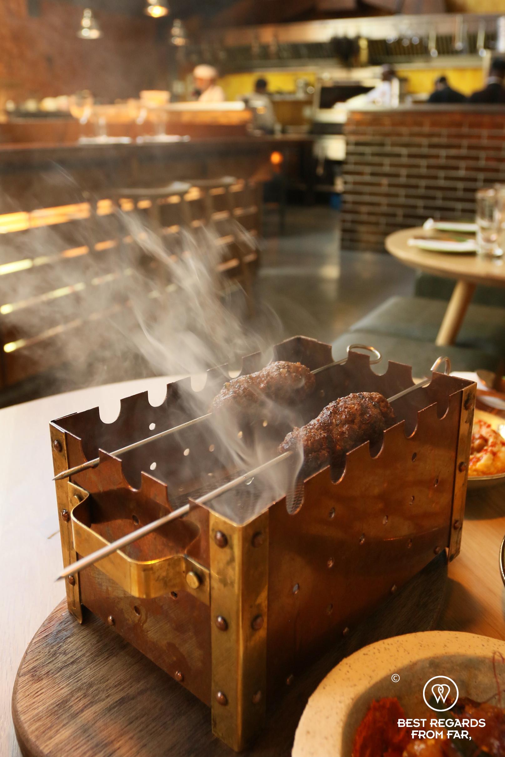 Smoking Turkish lamb kofta at the Chefs Warehouse Mazza, Cape Town