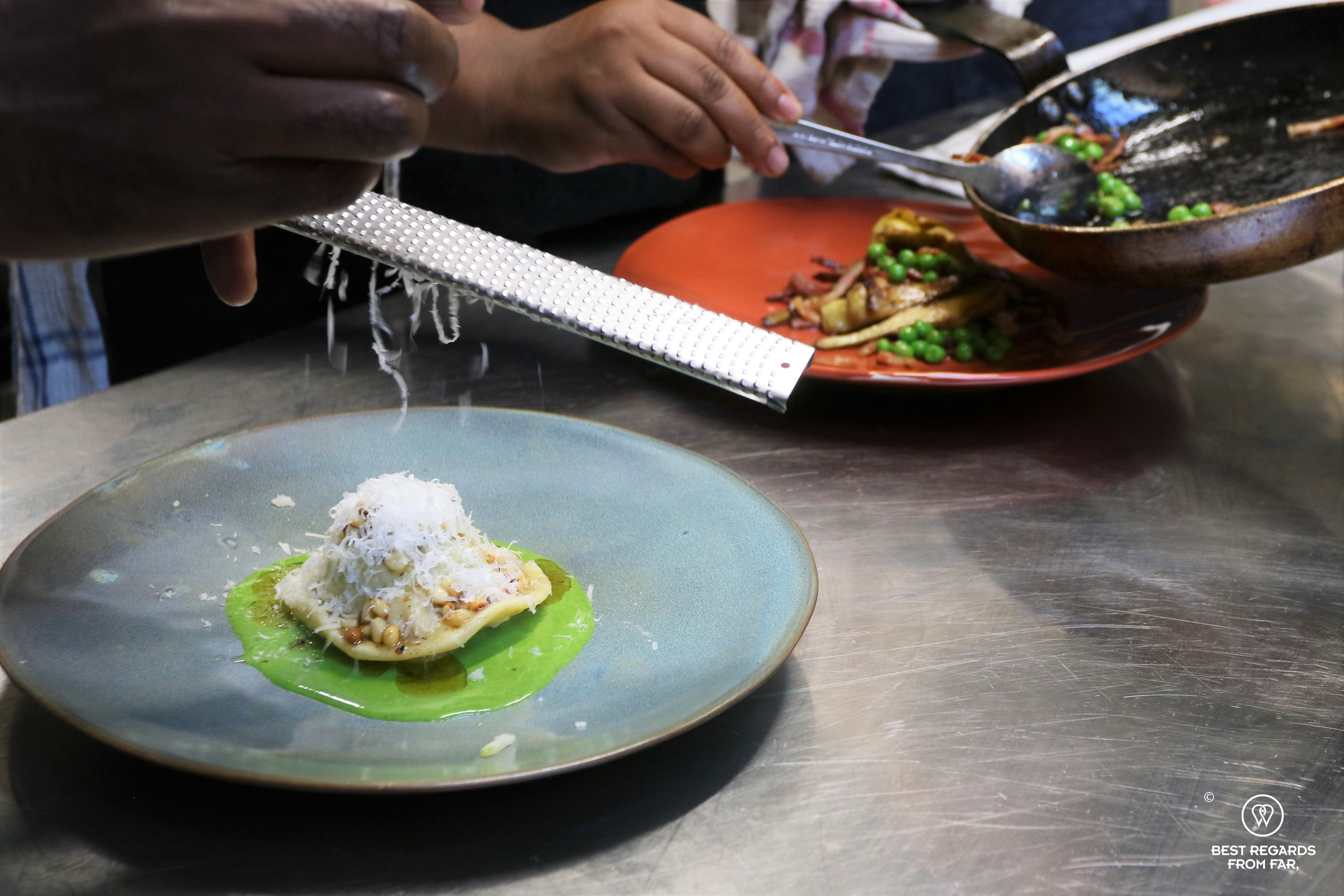 Close up of cooks preparing dishes in the kitchen of La Cantina at Local, Cape Town