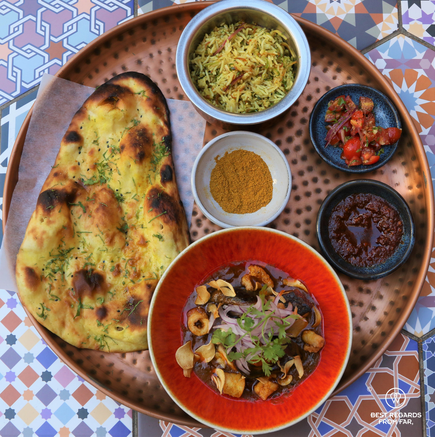 Tray with Indian tapas to share and a nan bread at Thali, Cape Town