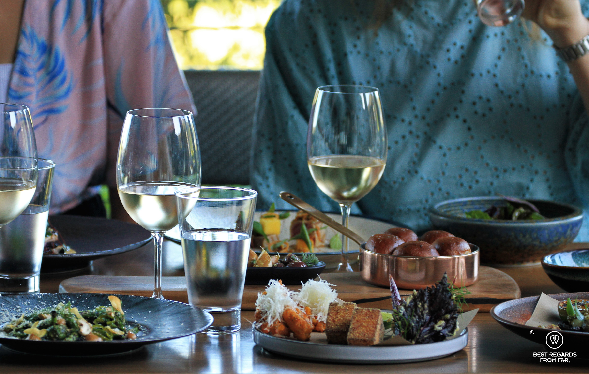 Guests seating for lunch and sharing tapas and wine at the Chefs Warehouse Beau Constantia