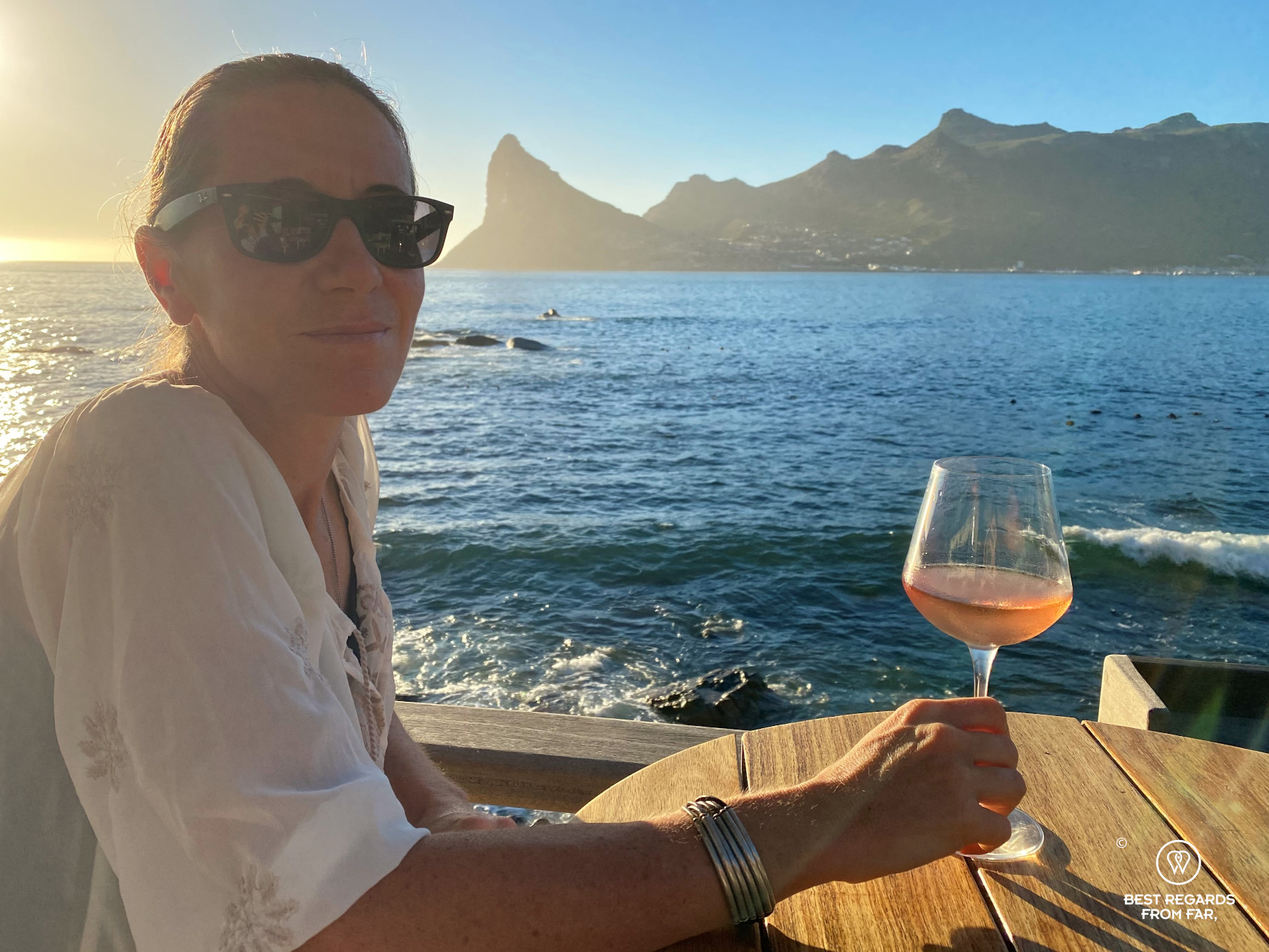 Author Claire Lessiau enjoying the view on Hout Bay at the Chefs Warehouse Tintswalo Atlantic with a glass of rosé