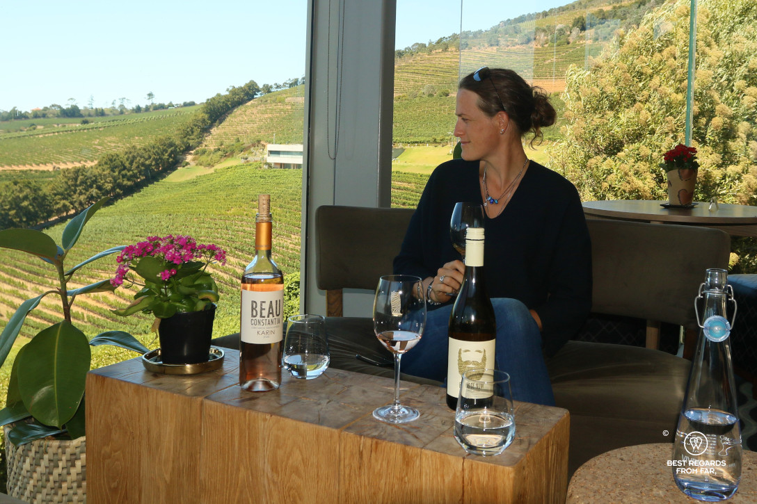 Photographer Marcella van Alphen tasting Beau Constantia wines overlooking the vineyards, Constantia wine route, Cape Town