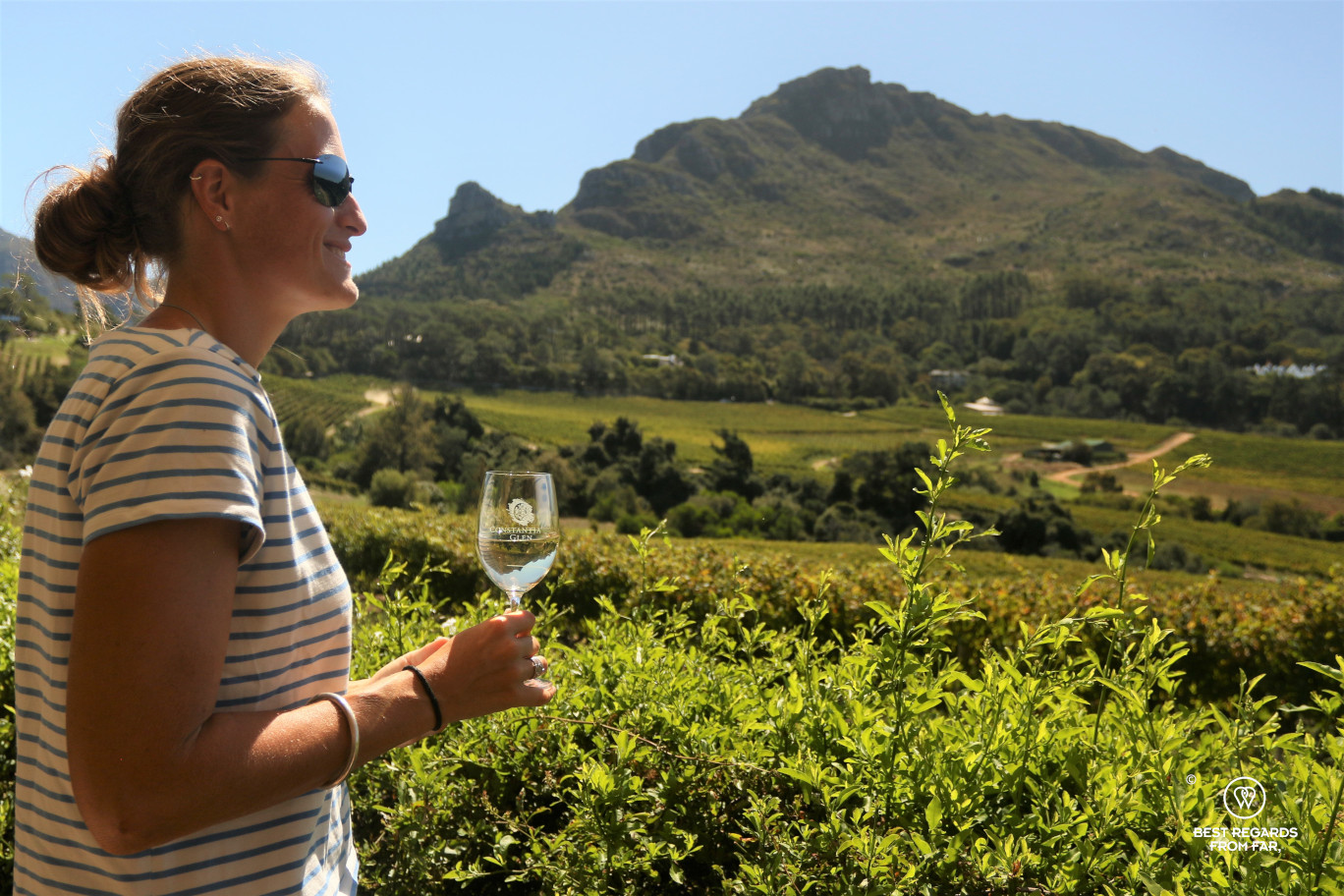 Photographer Marcella van Alphen wine tasting overlooking the Glen Constantia vineyard, Constantia wine route, Cape Town