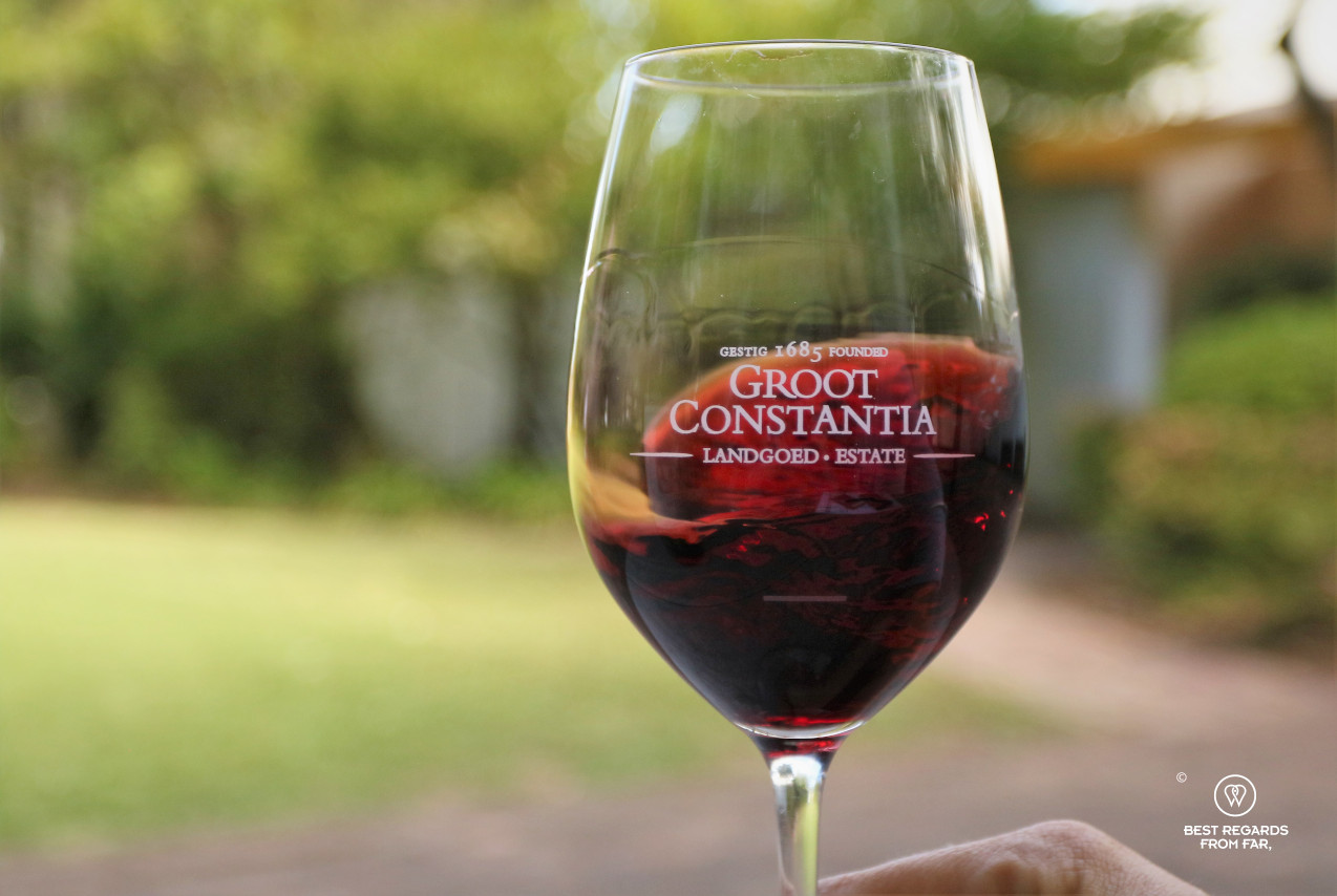 Red Groot Constantia wine in a branded glass for tasting, Constantia wine route, Cape Town
