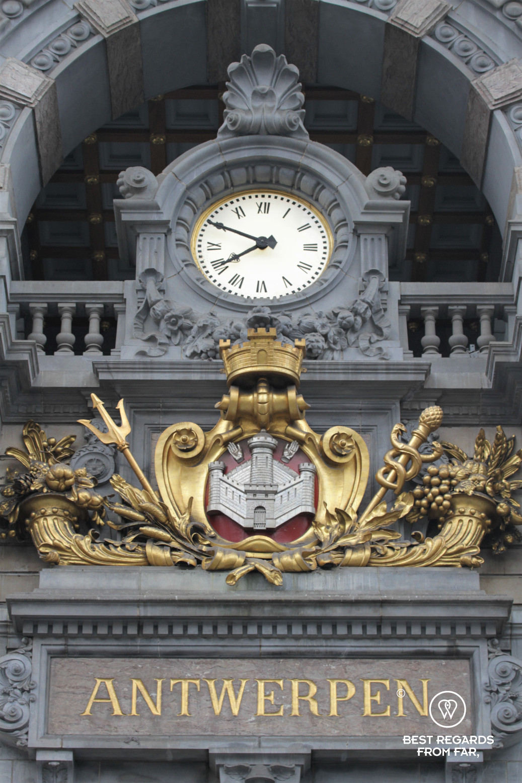 Station clock of Antwerp Central with its guilded weapon underneath