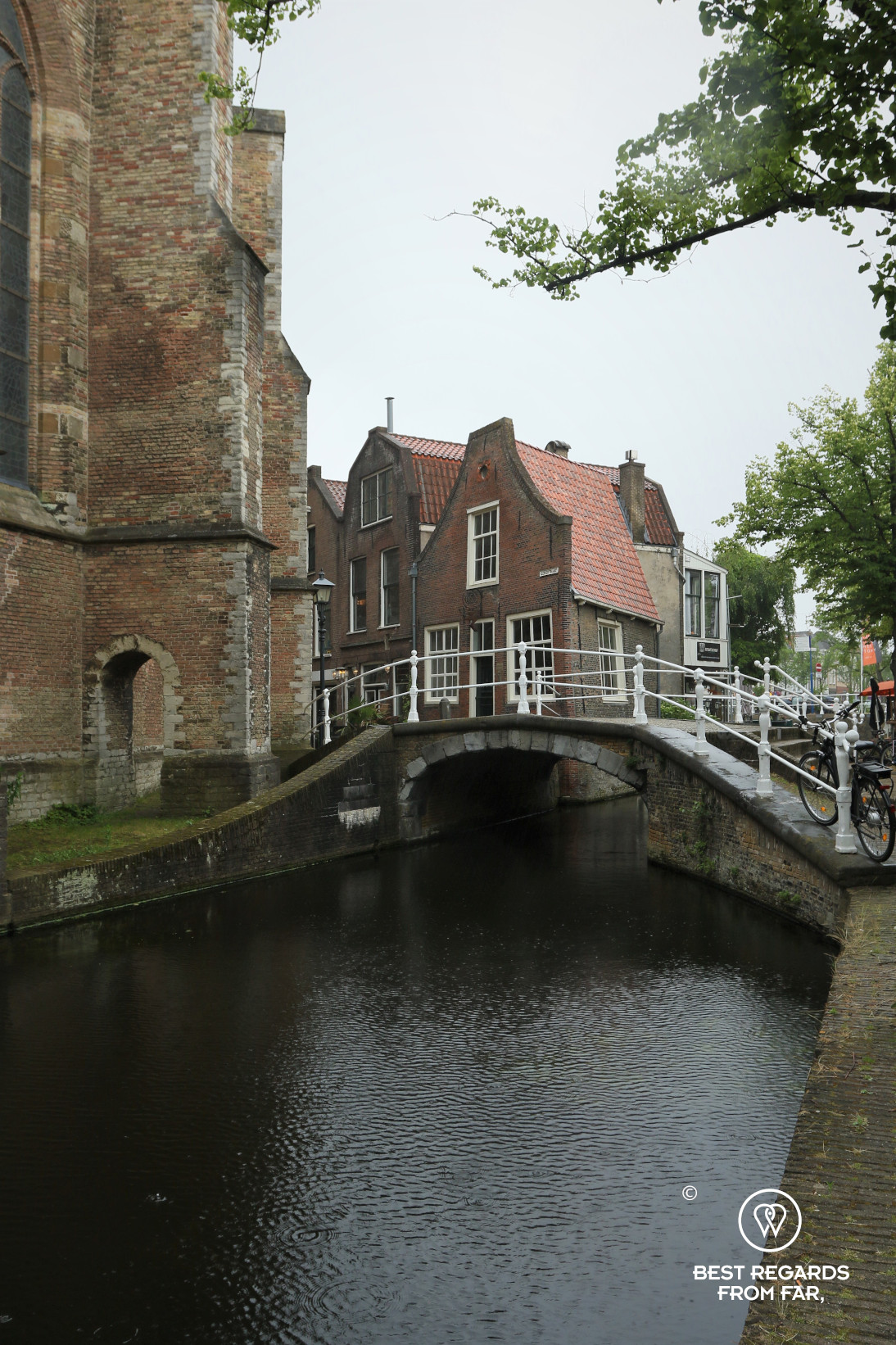 Old houses along a cute canal in Delft, The Netherlands