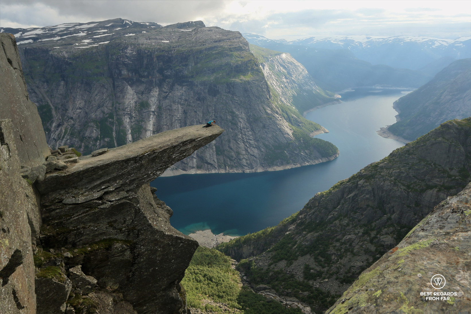 Woman looking over the edge of the Trolltunga in Norway