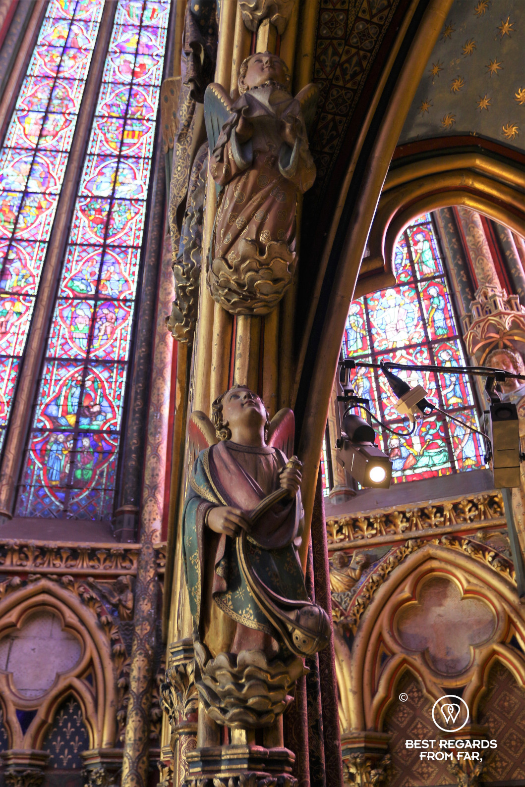 Close-up of angels in la Sainte Chapelle with its stained-glass windows in the background, Paris, France