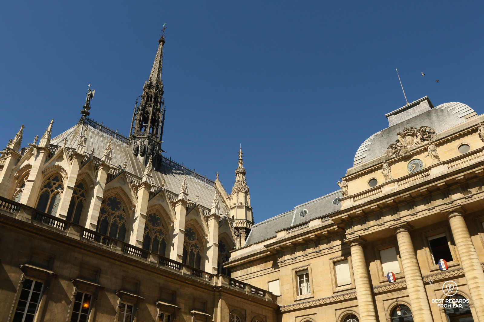 The exterior of La Sainte Chapelle in Paris, France contrasting with blue skies
