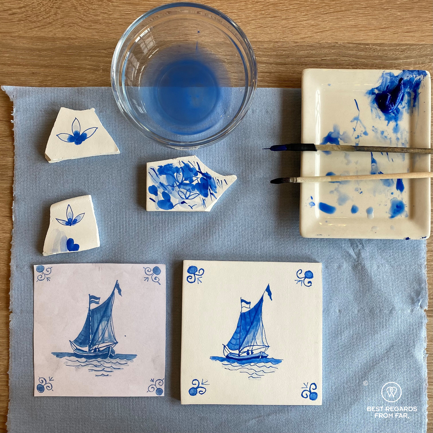 Sailboat reproduced by hand on a tile during a tile painting workshop at Royal Delft, the Netherlands