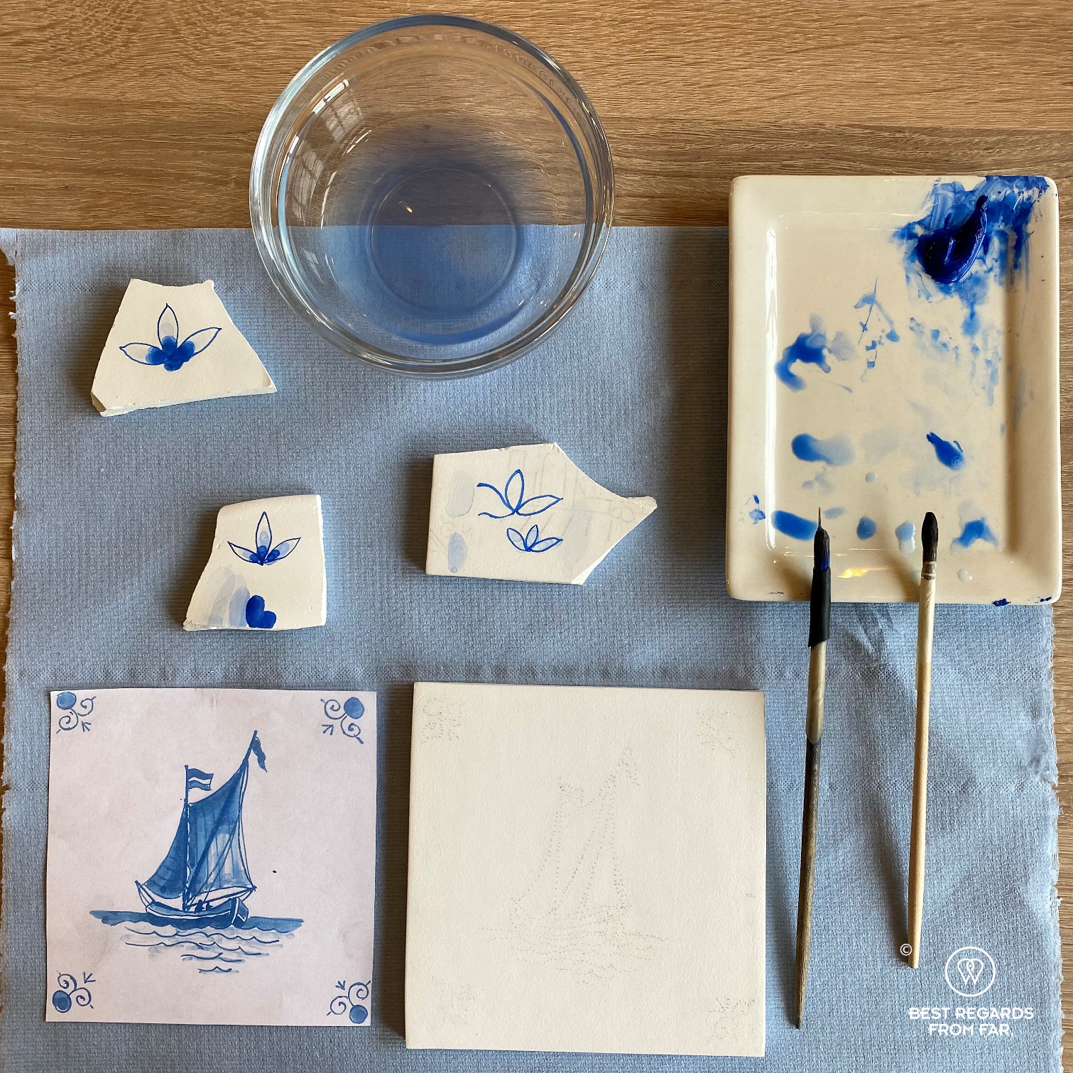 Contours of the motif of a sailboat on a tile during a tile painting workshop at Royal Delft, the Netherlands