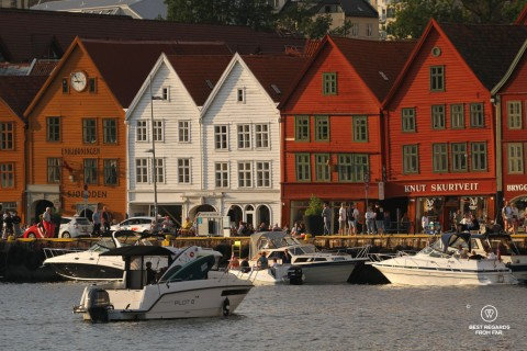 Colourful warehouses of Bryggen with boats in the foreground, Bergen