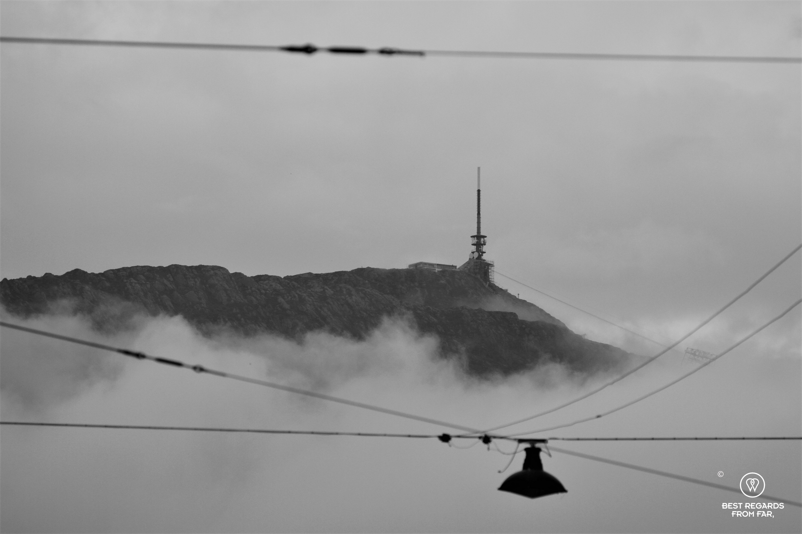 The mountain tops of Bergen in black and white