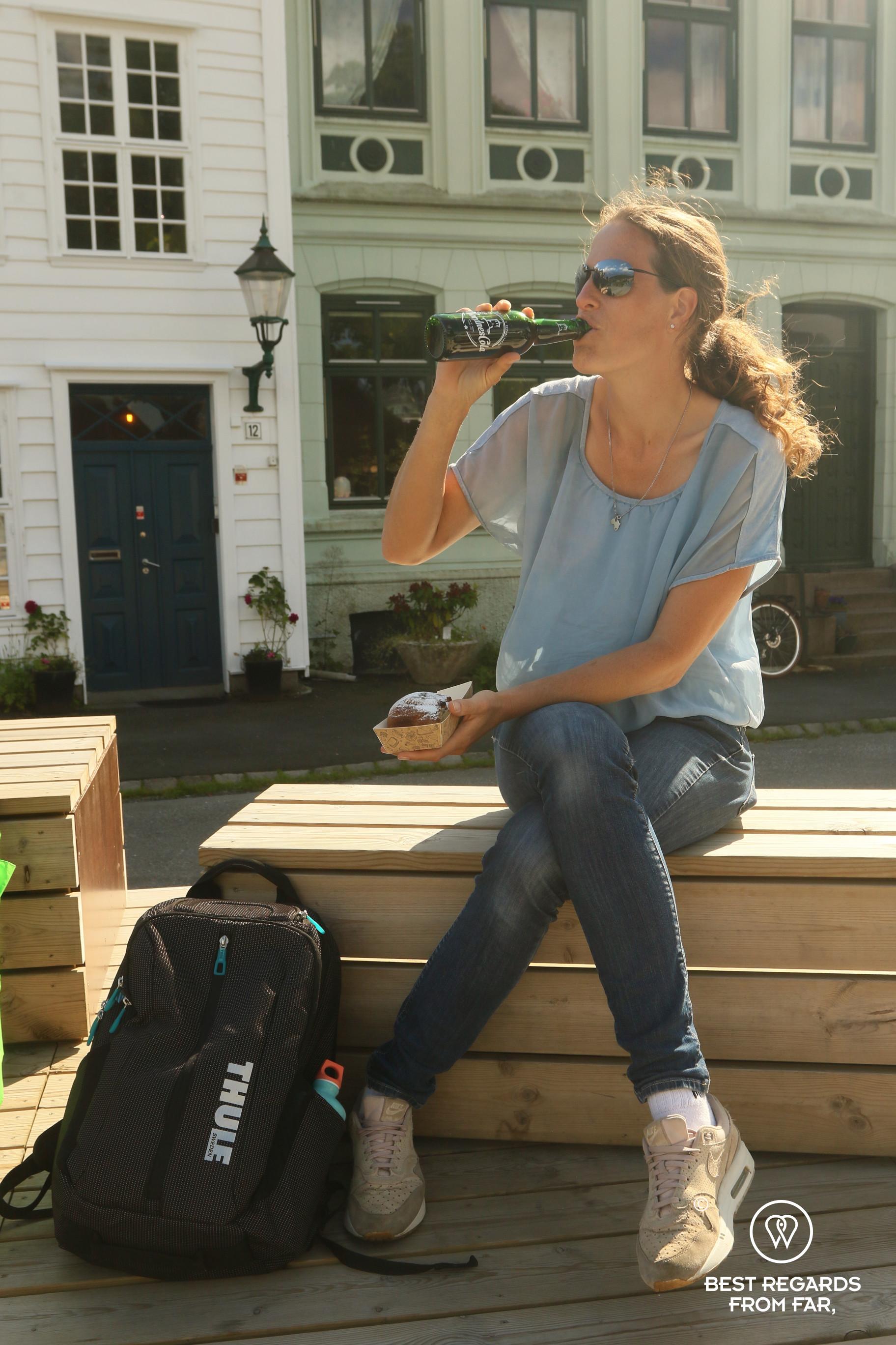 Author Marcella van Alphen having a Nordness cola in Bergen
