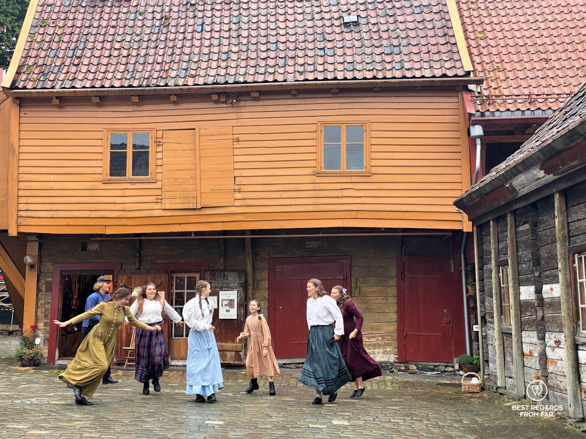 Teenagers in medieval costumes dancing in Bryggen, Bergen