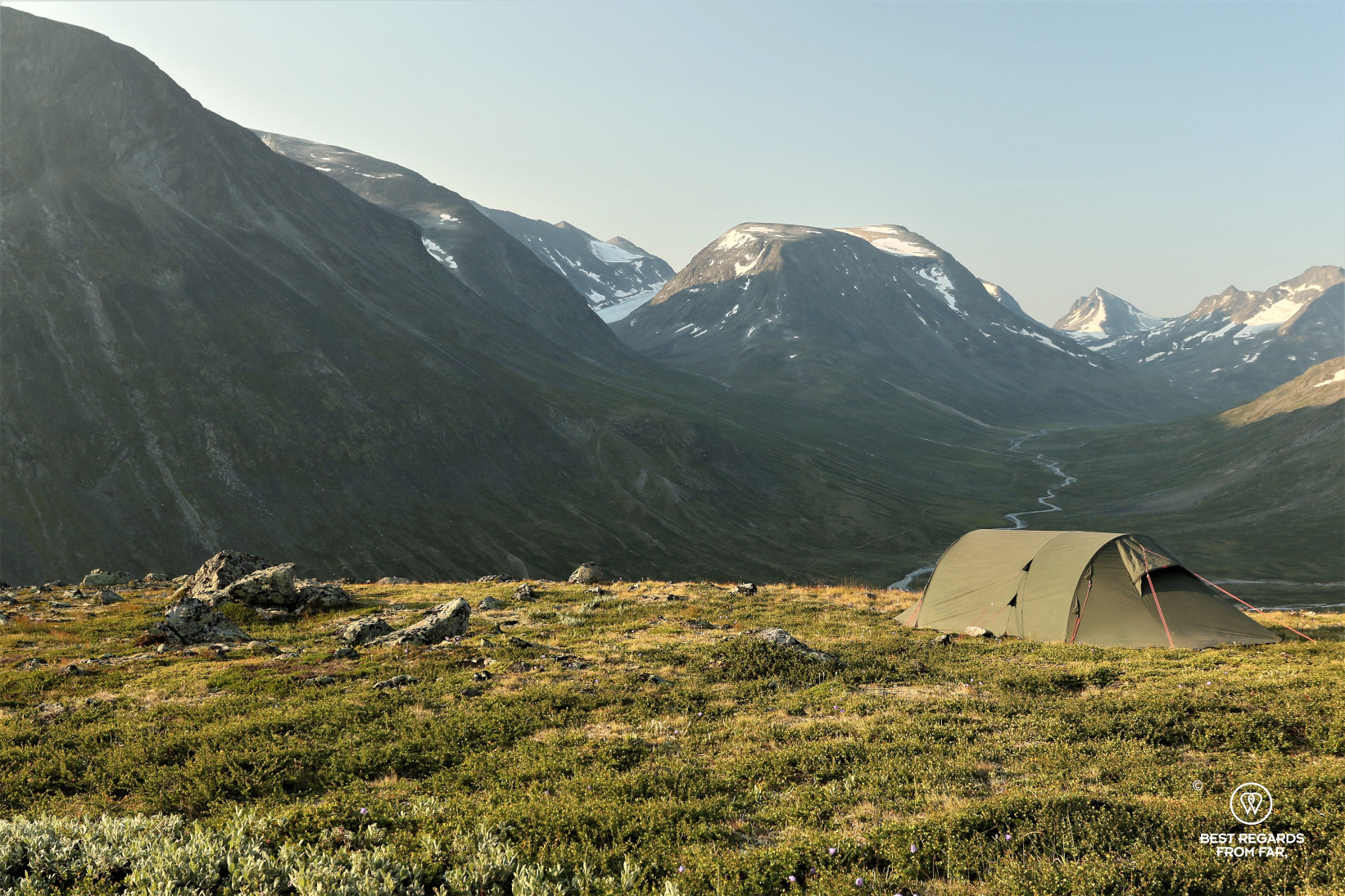 A green tent in the Arctic landscape of Norway