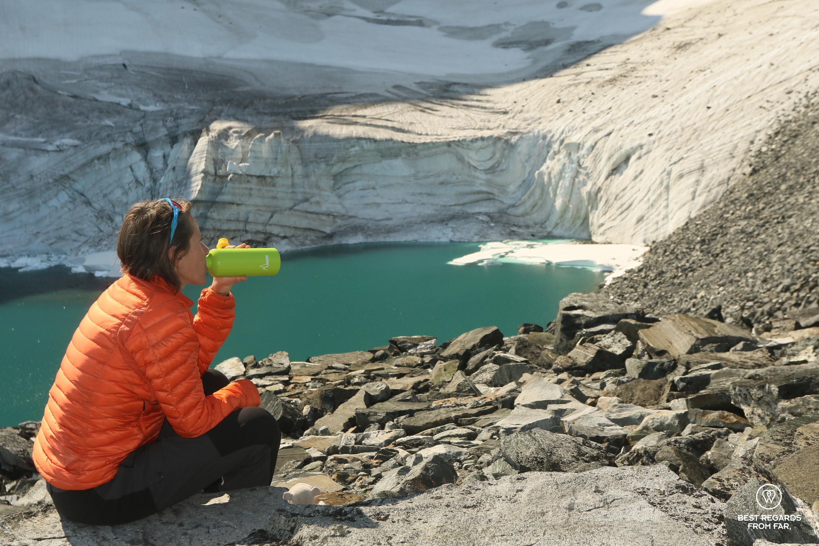 Author Claire Lessiau taking a break at a glacier lake