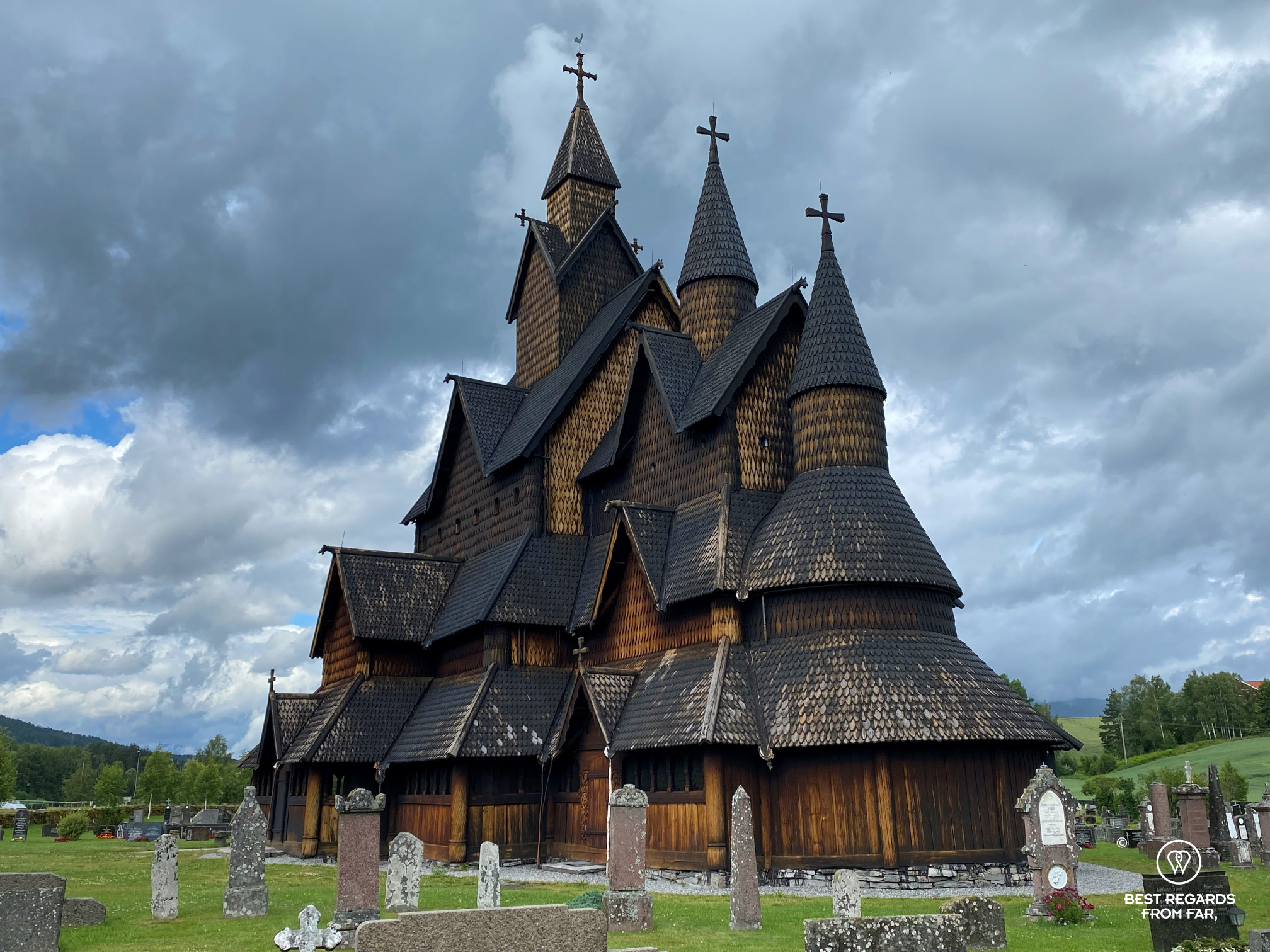Majestic Heddal Stave Church against a threatening sky