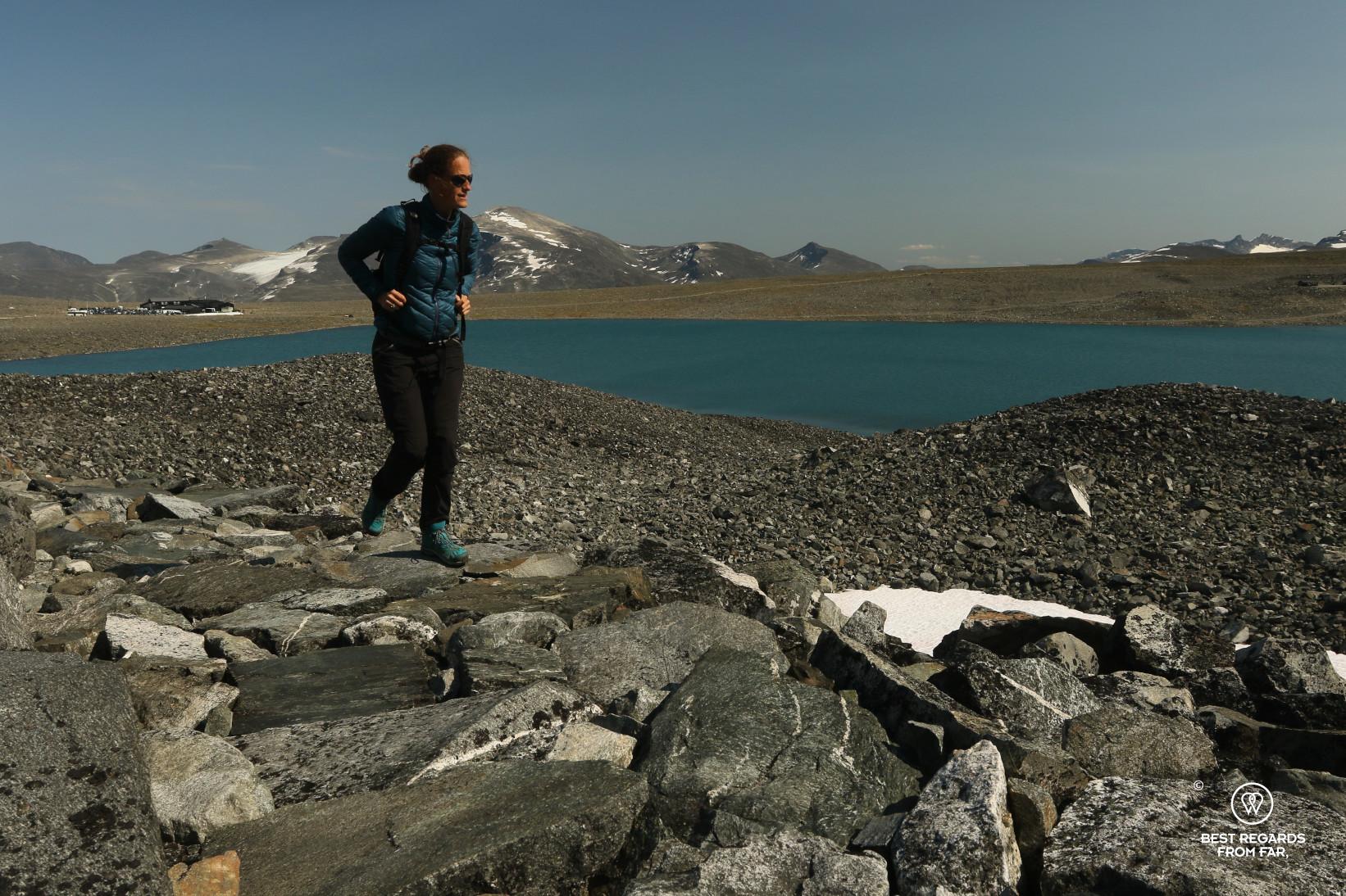 Author Marcella van Alphen walking along a glacier lake, Norway