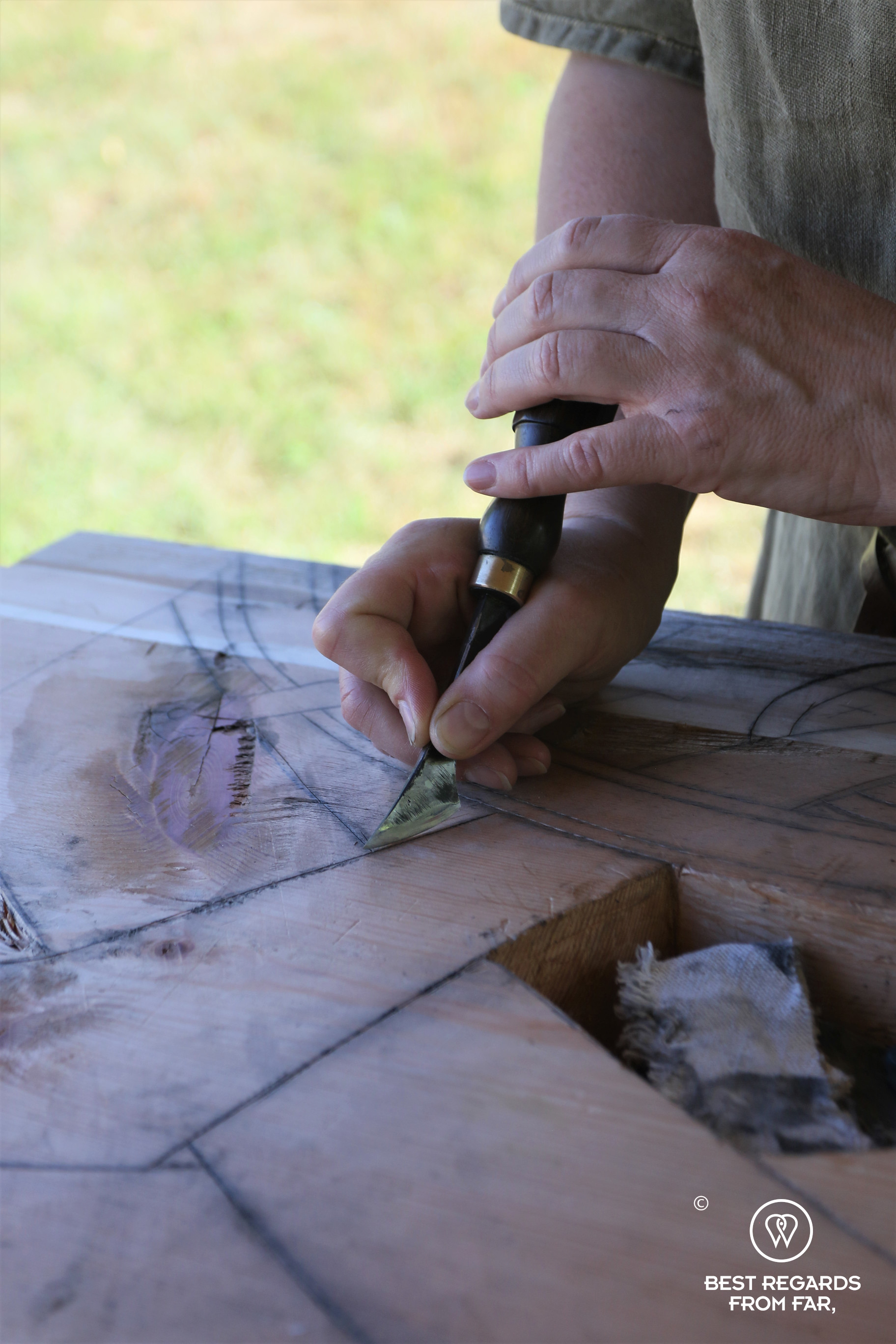 Hand of craftsman carving wood