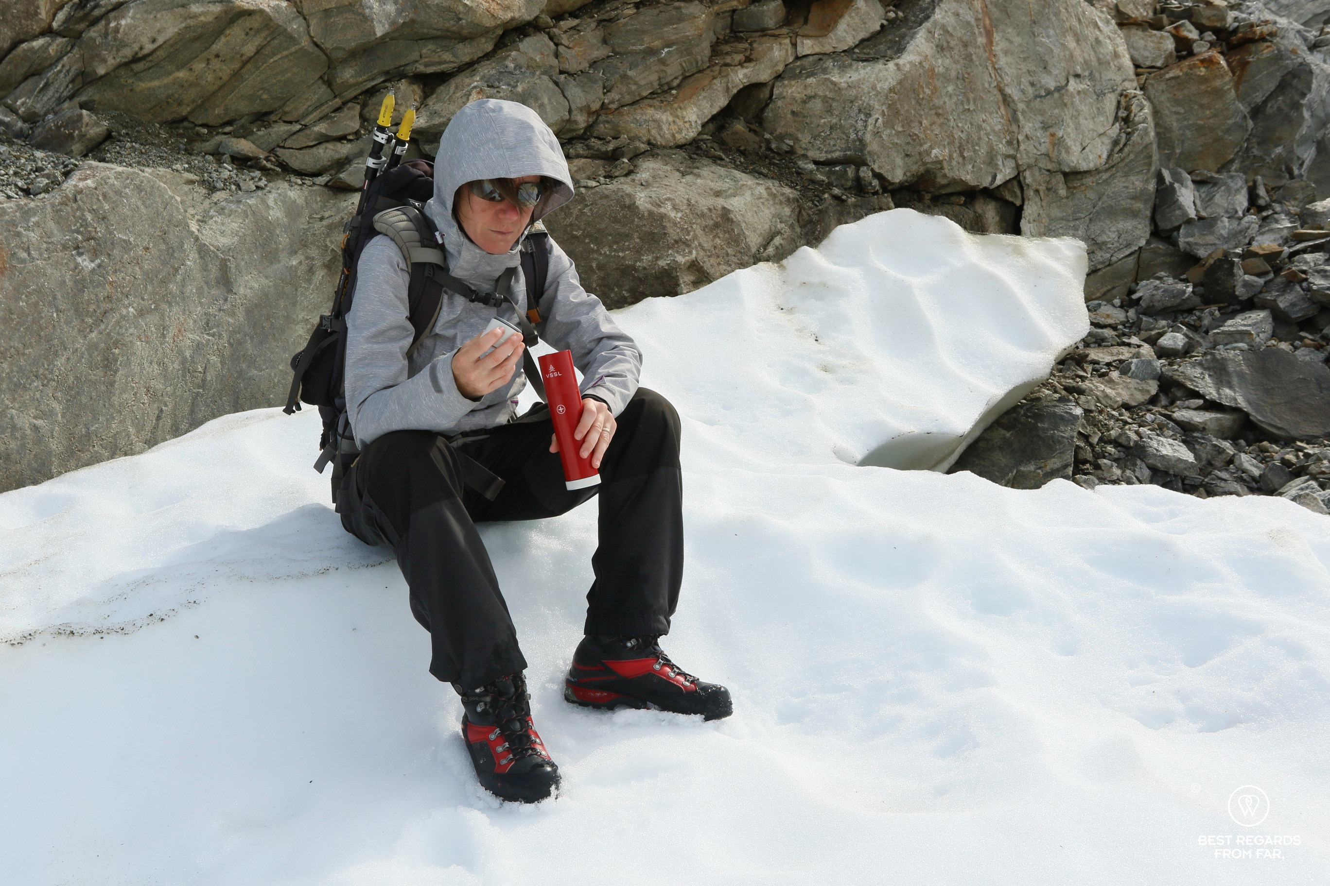 Checking the first aid gear before hiking on the glacier