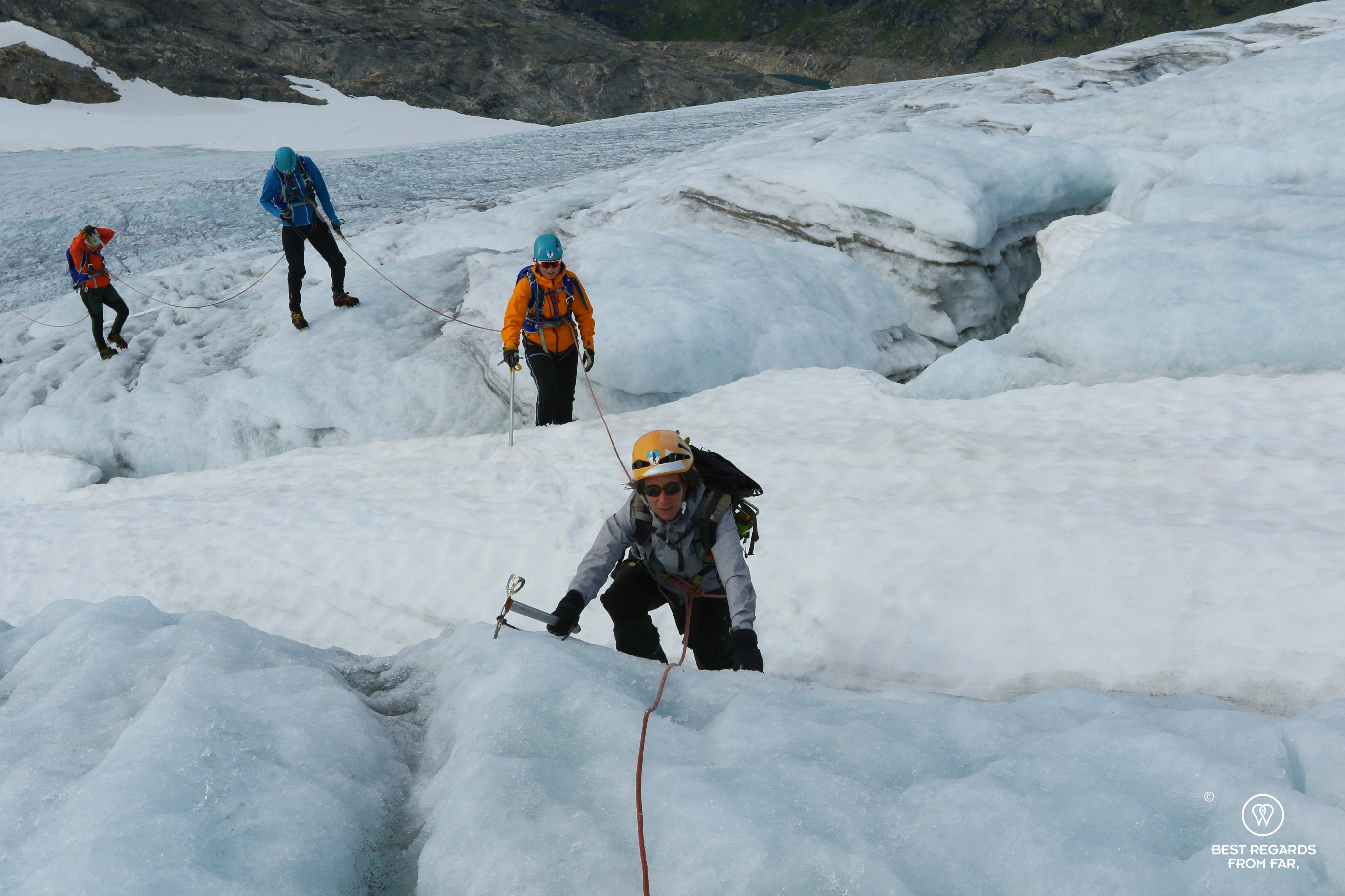 Photographer Claire Lessiau climbing out of a crevasse on the Fonna Glacier