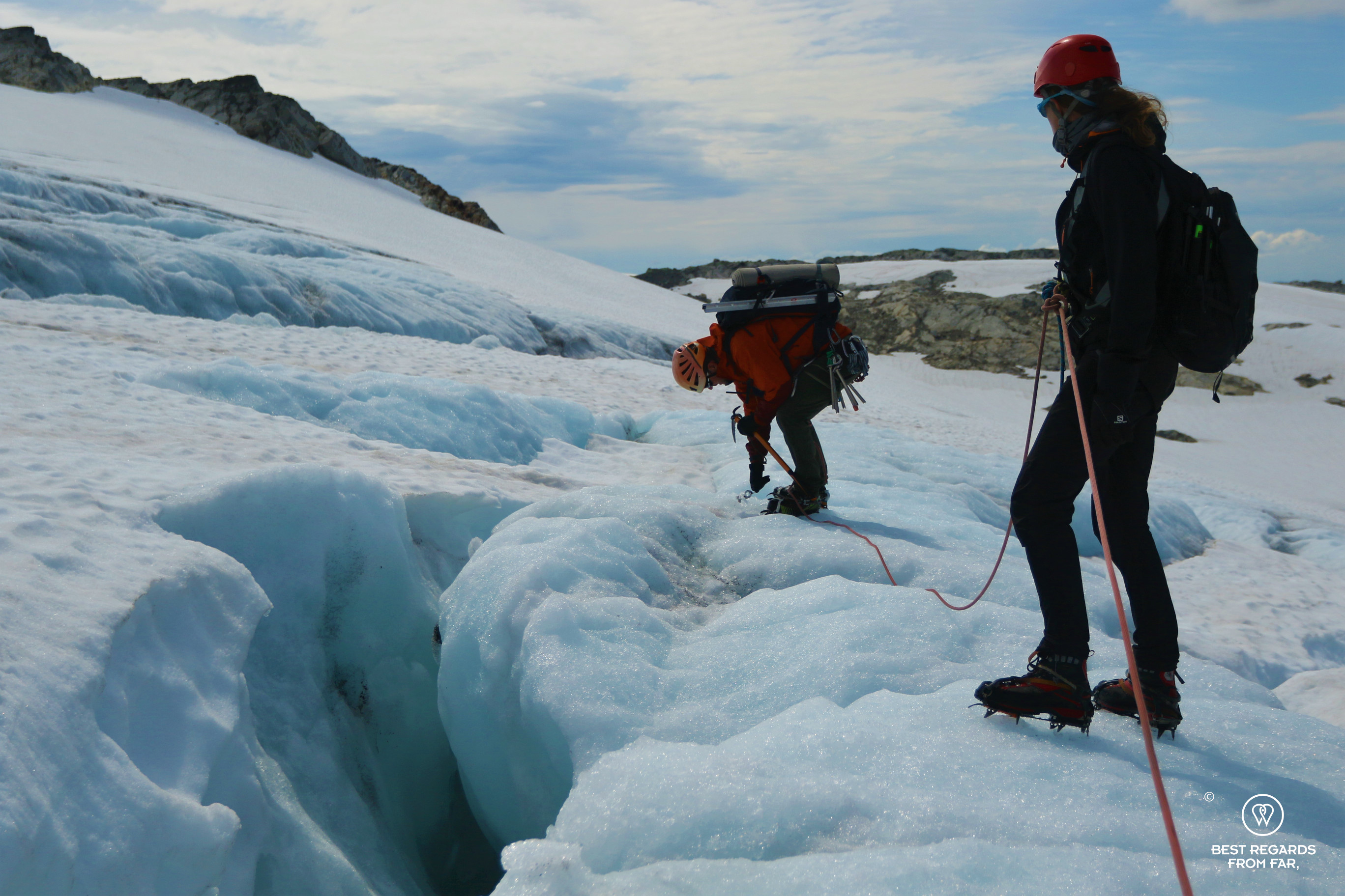 Author Marcella van Alphen progressing on the Fonna Glacier while the guide secures an ice screw