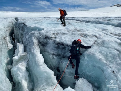 Author Marcella van Alphen coming out of a crevasse on the Fonna Glacier