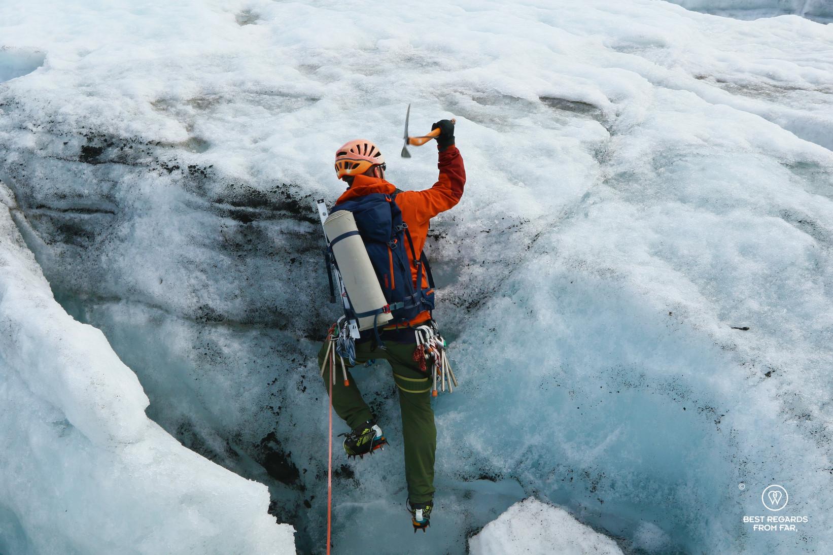 Guide Thorbjørn Helgesen coming out a crevasse on the Fonna Glacier