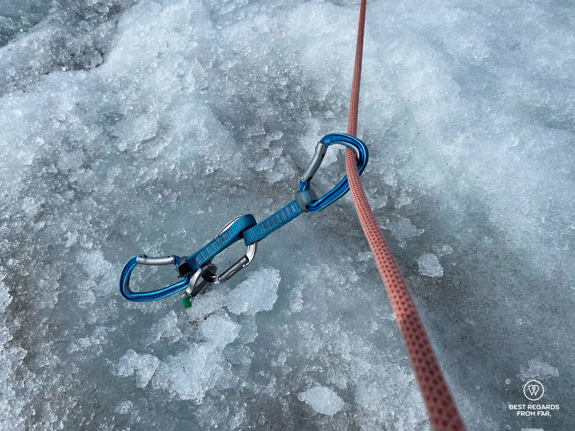 Rope secured in the glacier by an ice screw