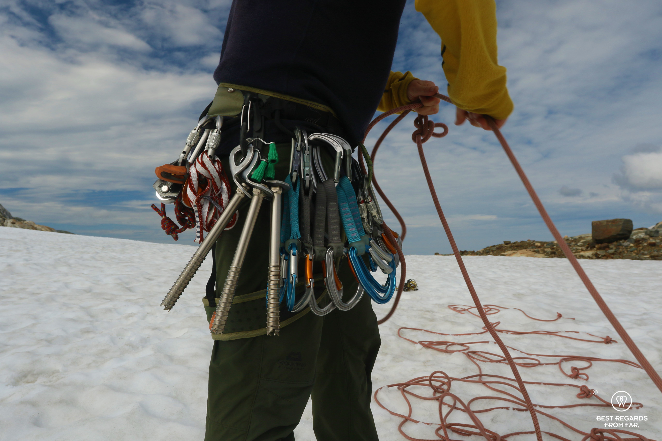 Gear of the guide while he is preparing the rope for the glacier hike