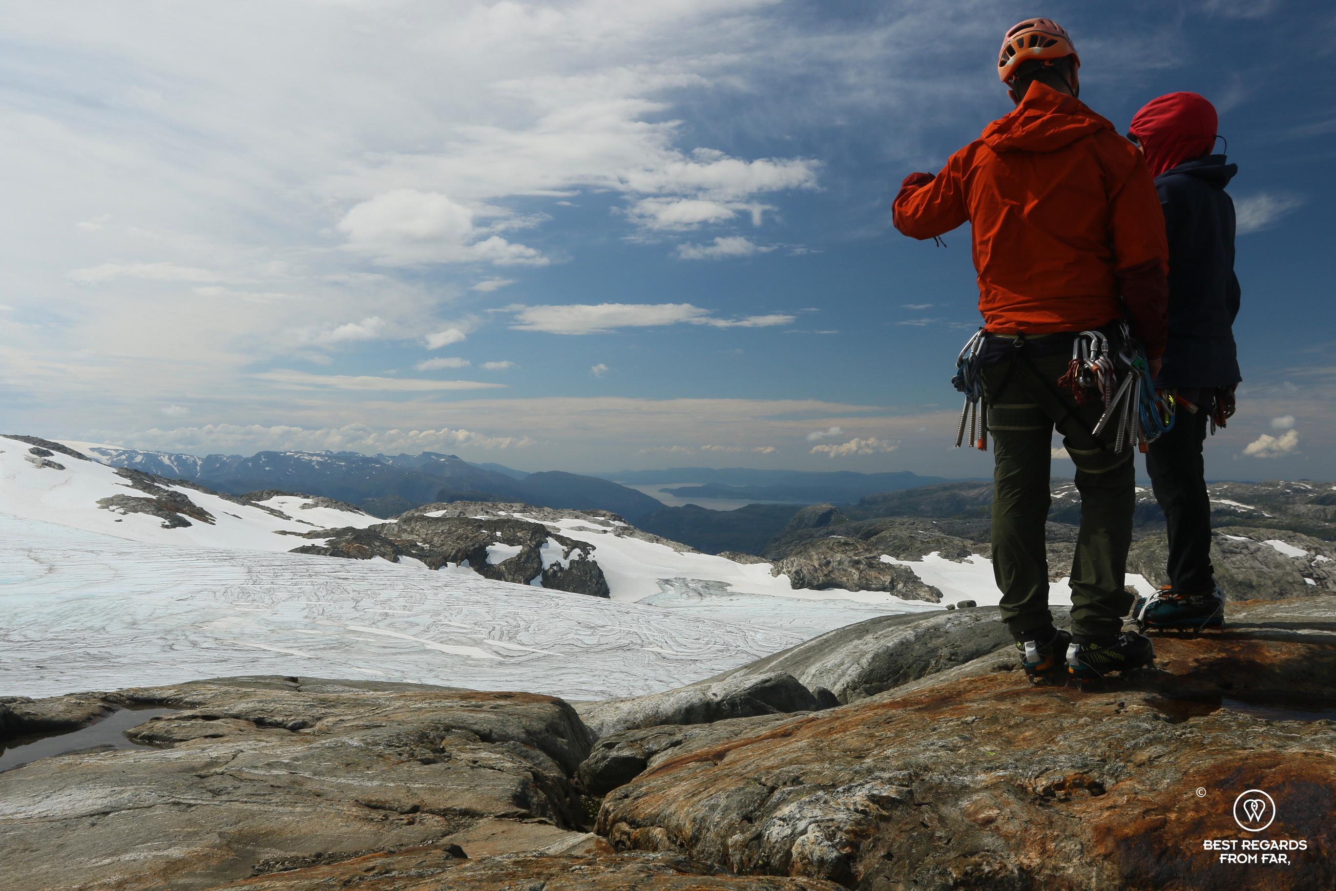 Guide Thorbjørn Helgesen assessing the route on the Fonna Glacier